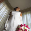 Low angle view of a young bride - Stock Photo