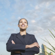 Stock Photo: Low angle view of businesswoman