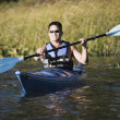 Young man canoeing — Stock Photo