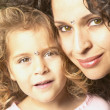Mother and daughter wearing bindis - Stock Photo
