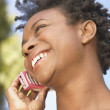 Close up of woman talking on cell phone — Stock Photo