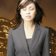 Businesswoman relaxing in front of city landscape — Stock Photo #18567205