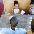 Family in booth at restaurant - Stock Photo