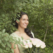 Young woman holding a flower arrangement — Stock Photo