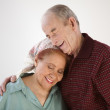 Elderly couple hugging — Stock Photo
