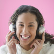 Teen girl listening to music with headset — Stock Photo