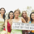 Small group of women holding sign — Stock Photo