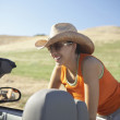 Young womleaning on convertible — Stock Photo #18568815