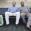 Portrait of two men at airport — Stock Photo