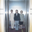 Portrait of three businesswomen in elevator — Stock Photo