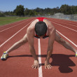 Male track runner stretching — Stock Photo