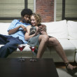 Couple hugging on couch — Stok fotoğraf