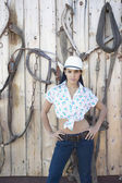 Young woman in a cowboy outfit posing for the camera — Stock Photo