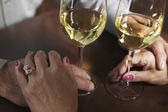 Hands holding wine glasses — Stock Photo