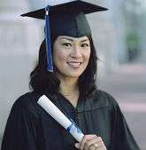 Graduate smiling for the camera — Stock Photo