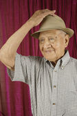 Elderly man tipping his hat — Stock Photo
