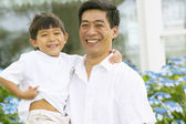 Portrait of father and son laughing — Stock Photo