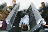 Businessman sleeping on airplane — Stock Photo