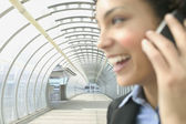 Profile of businesswoman on cell phone — Stock Photo