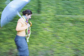 Woman walking with an umbrella — Stock Photo