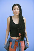 Portrait of teenage girl with long braided hair — Stock Photo
