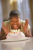 Woman celebrating her birthday — Stock Photo