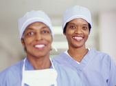 Two female surgeons smiling — Stock Photo