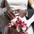 Стоковое фото: Groom holding his bride's waist