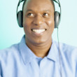 Man listening to music with headphones — Stock Photo