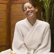 Woman in spa robe smiling — Stock Photo