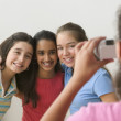 Girl taking picture of three girls — Stock Photo