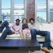 Portrait of group sitting on couch — Foto de Stock