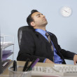 Businessman asleep at his desk — Stock Photo