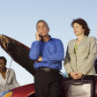 Group of businesspeople with car breakdown — Stock Photo