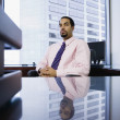 Businessman sitting behind desk — Stock Photo