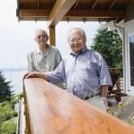 Portrait of two elderly men standing on deck — Stock Photo #18571731