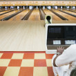 Man keeping score at bowling alley — Photo