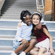 Portrait of two girls sitting on school stairs — Stock Photo