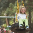 Girl swinging on tire swing — Stock Photo