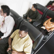 Stock Photo: High angle view of passengers on airplane
