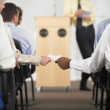 Hands exchanging note in business conference — Stock Photo