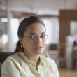 Portrait of businesswoman wearing glasses - Stock Photo