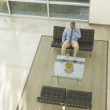 Businessman talking on a cell phone in lobby area — Foto de Stock