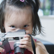 Stock Photo: Portrait of young girl with camera