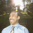 Businessman smiling in park — Foto Stock
