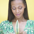 Young woman holding a leaf - Stock Photo