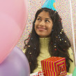 Stock Photo: Young womsmiling at birthday party