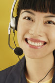 Portrait of businesswoman with headset — Stock Photo