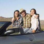 Portrait of friends sitting in convertible — Stock Photo