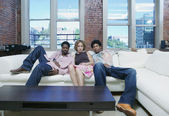 Portrait of group sitting on couch — Stock Photo